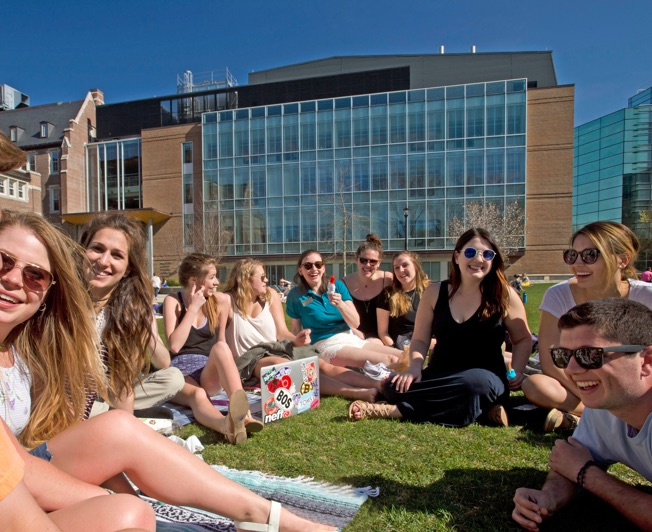 Students hanging out outside during a college summer class session
