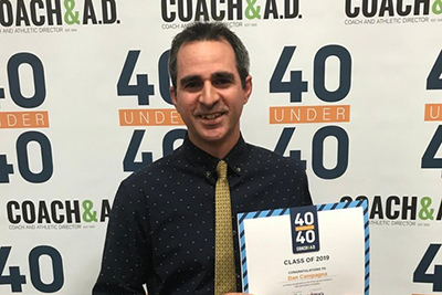 "Dan Campagna standing with his award, which reads ""40 Under 40 Class of 2019 Recipient"""